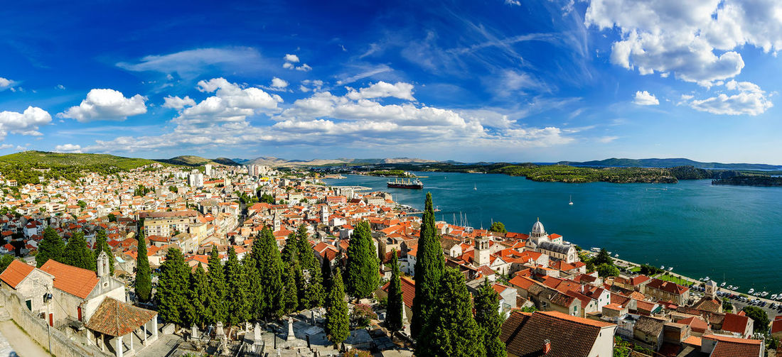 Amazing panorama view of Sibenik city in Croatia. Northern part of Dalmatia. Sunny detail of beautiful town. Summer day with blue sky and clear sea. Croatia Zadar Architecture Building Built Structure City Cityscape Cloud - Sky Dalmatia Day High Angle View Island Kornati Island Nature No People Outdoors Plant Residential District Sea Sibenik Sky Town TOWNSCAPE Tree Water