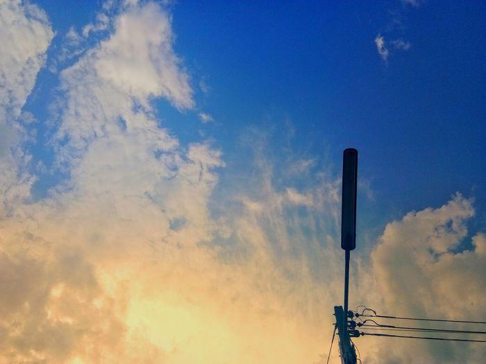 ตะวันลับฟ้า Sunset Blue Sky Cloud - Sky Smoke Stack Air Pollution Road Signal Forest Fire Road Sign Television Aerial Telephone Pole Sky Only Green Light Speed Limit Sign Traffic Arrow Sign Smoke Chimney Traffic Light  Stoplight Red Light Telephone Line Atmospheric