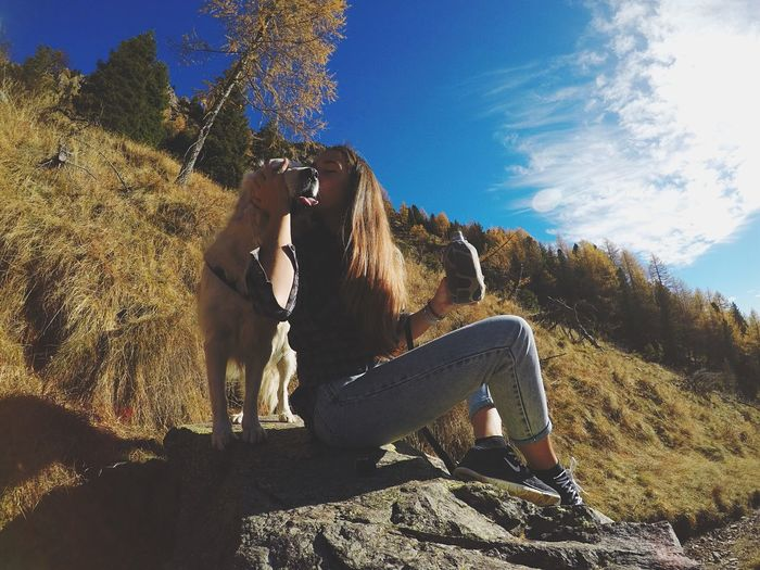 Goldenretriever Animal Themes Sunlight Full Length Tree Day One Animal Mammal Sky Nature Domestic Animals Outdoors Shadow Low Angle View Real People One Person Grass
