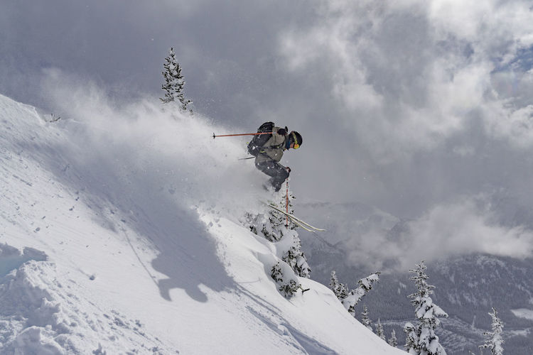 Active Adventure Air Fast Fresh Fresh Pow Full Frame Jump Jumping Leisure Activity Motion Mountain One Person Outdoors Powder Ski Ski Holiday Skier Skill  Snow Speed Sport Stunt Winter Winter Sport Go Higher