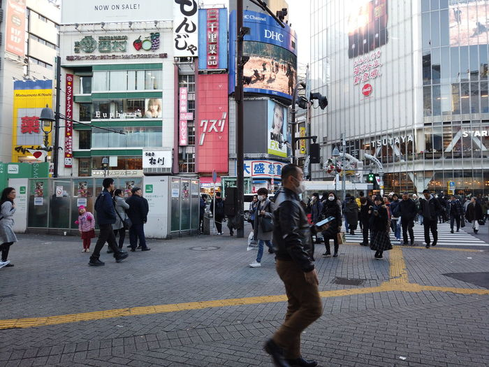 Streetphotography Urban Cityscape City People Urban Life Tokyo Japan Travel Shibuyacrossing Building Exterior Group Of People Architecture Built Structure Crowd Large Group Of People City Life Street Real People Men Transportation Walking Women City Street Road Adult Day Lifestyles Outdoors