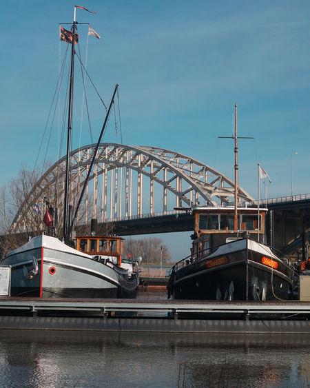 Nijmegen Waalbrug Nijmegen Waal Bridge - Man Made Structure Harbor Nautical Vessel Travel Destinations Business Finance And Industry Transportation Built Structure