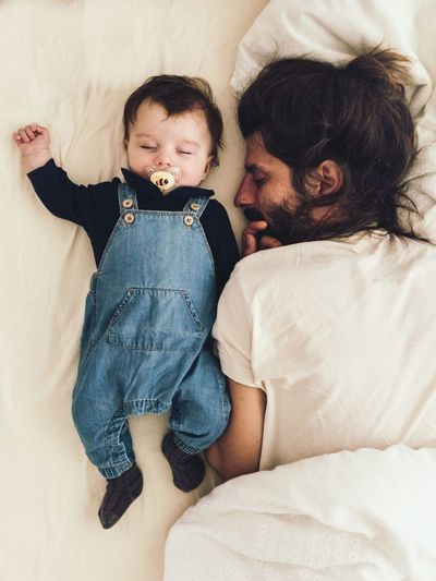 father and baby taking a nap in the afternoon Daddy Parenthood Fatherhood Moments Cuddling Dungarees Sleeping Nap Childhood Child Togetherness Baby Young Two People Bed Real People Indoors  Babyhood Bonding Toddler  Casual Clothing Lifestyles Love