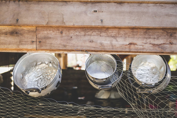 Close-Up Of Cooking Utensils Hanging From Wood