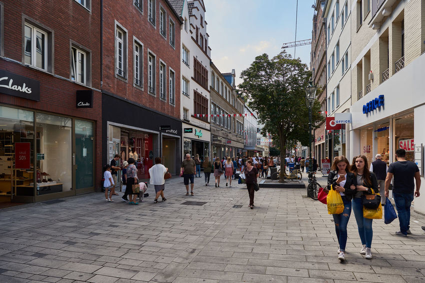 DUESSELDIRF, GERMANY - AUGUST 17, 2016: Tourists, visitors, and shoppers stroll along one of the Altstadt shopping streets. Alstd Colorful Diversity Düsseldorf High Resolution Lifestyle People Rheine Shopping Tourism Travel Turis Destina Walking Around Water