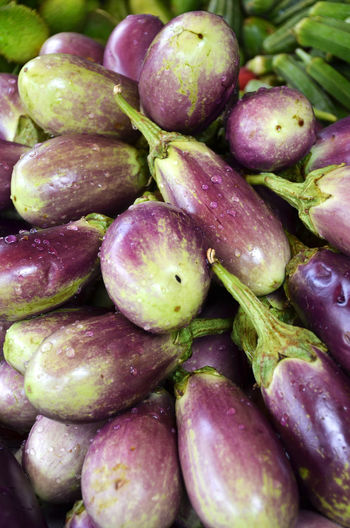 High angle view of eggplants for sale at market stall