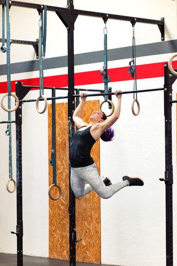 Young woman exercising at gym