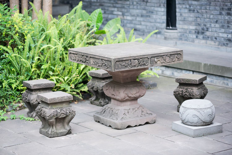 Antique Ancient Chinese Table Antique China Art And Craft Chinese Chinese Object Day Growth Human Representation Nature No People Outdoors Religion Sculpture Spirituality Statue Stone Material Stone Site Stone Table