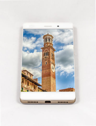 Modern smartphone with full screen picture of Verona, Italy. Concept for travel smartphone photography. All images in this composition are made by me and separately available on my portfolio Architecture Belief Bell Tower - Tower Building Building Exterior Built Structure Clock Clock Tower Cloud - Sky Day Low Angle View Nature No People Outdoors Place Of Worship Religion Sky Spirituality Tower Window