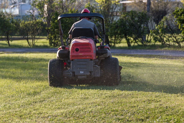 Grass Plant Transportation Day Mode Of Transportation Sunlight Green Color Nature Tree Field Land Vehicle Golf Land Outdoors No People Agricultural Machinery Golf Cart Lawn Machinery Agricultural Equipment Gardening