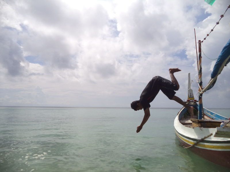 Jumping with style 1 Water Sea Cloud - Sky Sky One Person Full Length Day Horizon Over Water Nature Transportation Men Nautical Vessel Beauty In Nature Horizon Real People Leisure Activity Scenics - Nature Waterfront Outdoors Jumping Style Boat