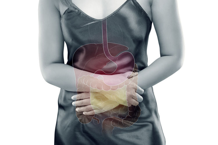 Digital composite image of woman with stomachache against white background