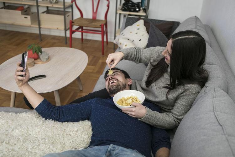 People sitting on sofa