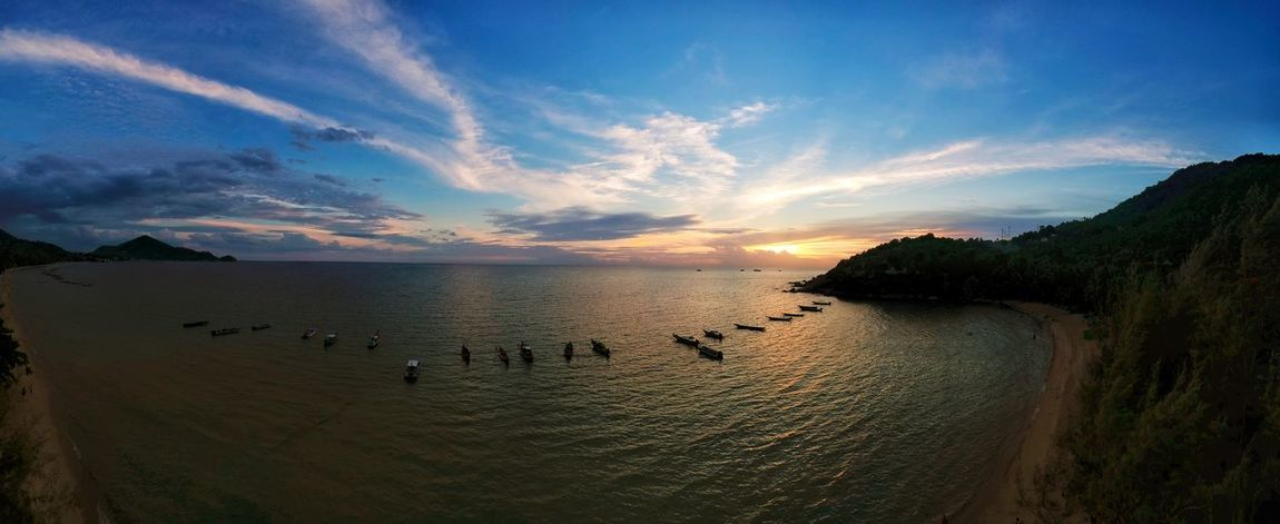 Panoramic aerial view of beautiful tropical sunset at Sairee beach with boats, blue sky and clouds. Koh Tao, Thailand. Summer Vacation Holiday Water Sea Sky Land Scenics - Nature Beach Beauty In Nature Cloud - Sky Tranquility Tranquil Scene Nature Sunset Idyllic Sand Holiday Travel Outdoors