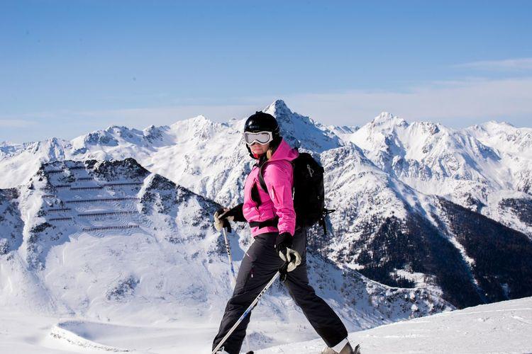 Full length of woman skiing on mountain