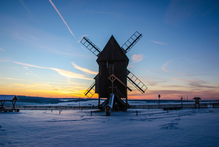Sky Sunset Water Snow Nature Cold Temperature Scenics - Nature Beauty In Nature Winter Tranquility Built Structure Architecture Tranquil Scene Land Sea No People Environment Non-urban Scene Outdoors Mill