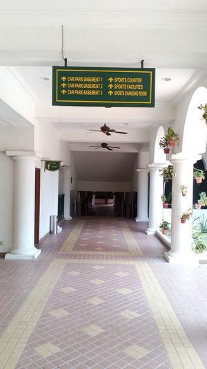 Signage Corridor View Corridor Hanging Flowers Passageway Passages Pillars With Plants Pillars Support Floor Tiles Flooring Directions Directional Sign