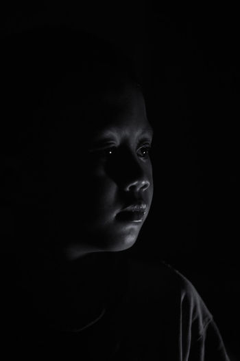 in the dark Dark Rimlight Bnw Black And White Blackandwhite Blackandwhite Photography Blacknwhite Black Background Witch Portrait Human Face Spooky Looking At Camera Headshot Horror