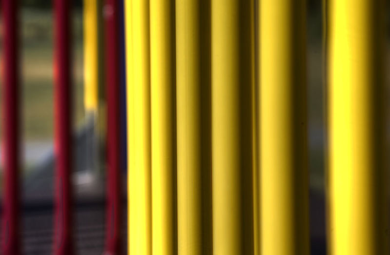 Playground Equipment Backgrounds Close-up Day Full Frame LINE No People Pipes, Metal Pipes, Stripes, Bars, Yellow