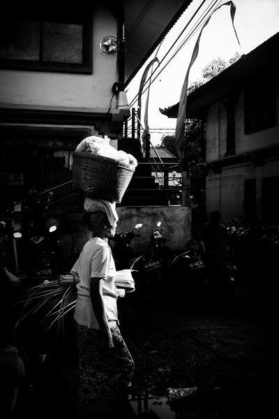 Bali Street Photography City Real People Clothing One Person Incidental People Street Women Side View Market Lifestyles Harsh Light Chasingharshlight Bali Ubud Pasar Strideby Woman Basket Balancing Act Balance Carrying On Head Blackandwhite Monochrome Street Photography