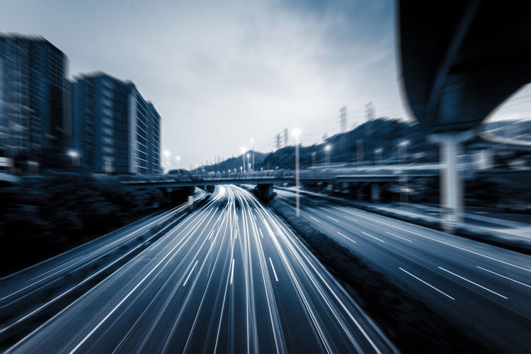 Blurred motion of highway against sky in city