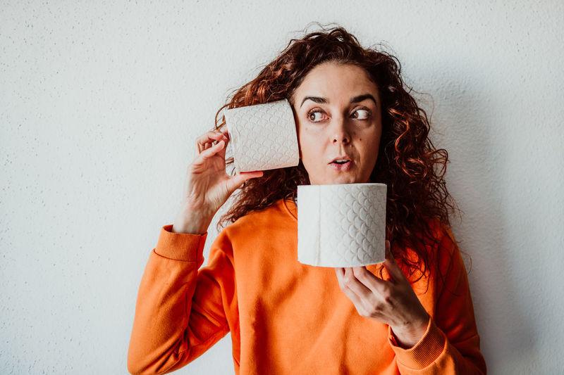Woman holding tissue rolls