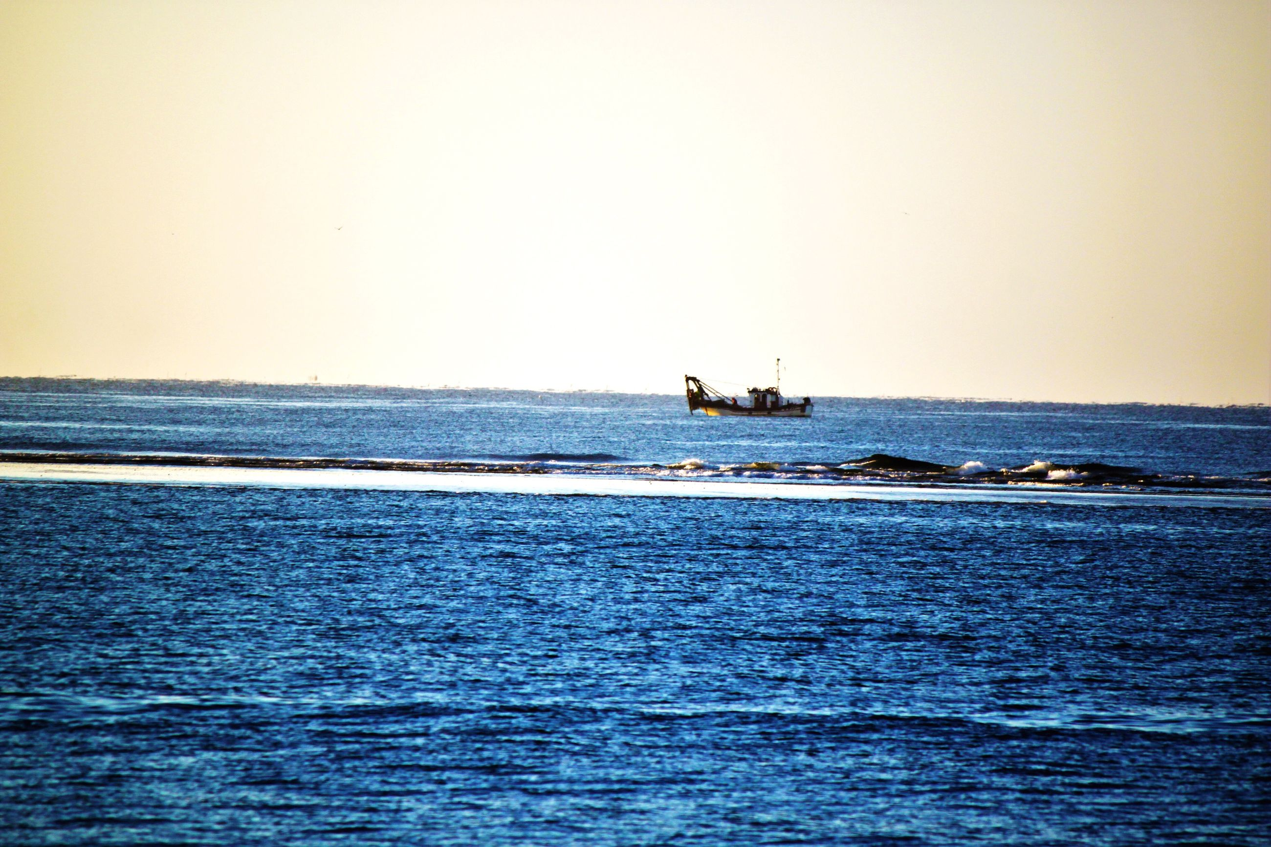 nautical vessel, transportation, water, sea, boat, mode of transport, waterfront, copy space, clear sky, scenics, calm, tranquil scene, sailing, tranquility, nature, beauty in nature, outdoors, ocean, day, blue, journey, no people