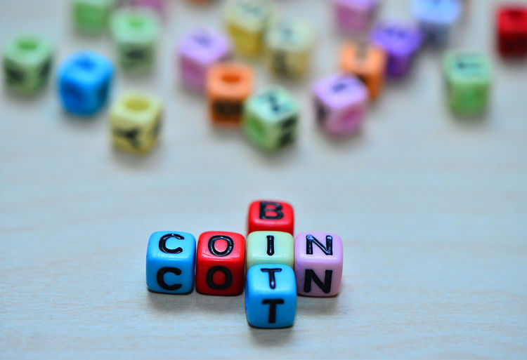 Bitcoin text dice on wooden background. Digital Bitcoin Money Business Dice Currency Gamble Electronic Banking Gold Internet Market Finance RISK Exchange Financial Cash Golden Virtual Coin Bank Economy Pay Cryptography Payment Concept Win Gambling