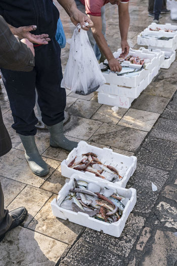 Low section of vendors selling fish at market