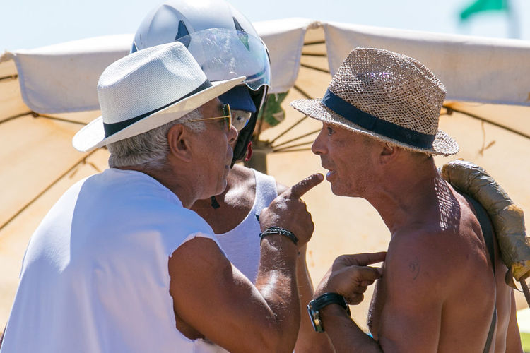 arguing at the beach! Arguing  Arguing With Flame Beach Life Beach Photography Casual Clothing Cropped Day Leisure Activity Lifestyles Outdoors Part Of Telling Stories Differently Up Close Street Photography The Street Photographer - 2016 EyeEm Awards The Photojournalist - 2016 EyeEm Awards