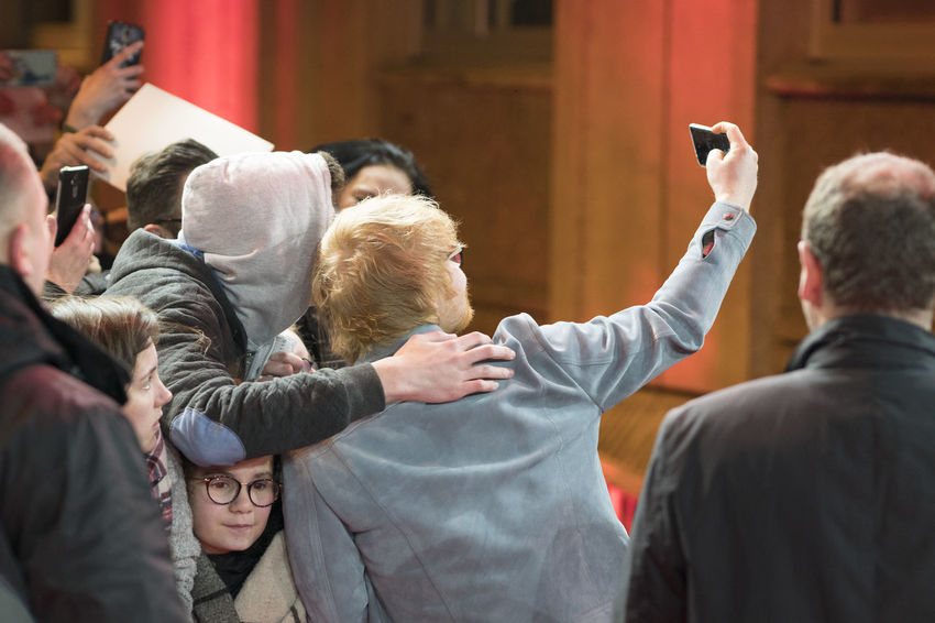 Berlin, Germany - February 23, 2018: Ed Sheeran poses for a selfie with a fan while attending the 'Songwriter' premiere during the 68th Berlinale International Film Festival Berlin 2018 Artist Celebrity Ed Sheeran Ed Sheeran <3 Ed Sheraan❤ Famous Singer  Singer/Song Writer Berlinale Berlinale 2018 Berlinale Festival Berlinale2018 Berlinale68 Celebrities Communication Crowd Famous People Fans Group Of People People Real People Rear View Singer And Artist Song Writer Technology