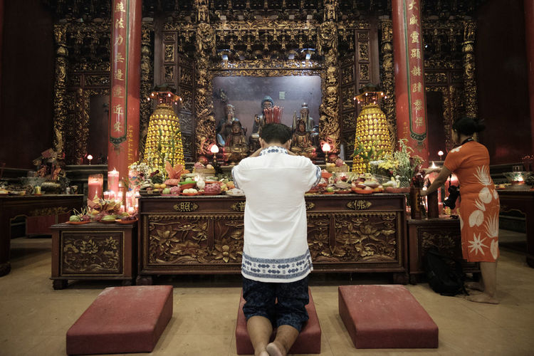 Benoa, Bali, Indonesia - January 28, 2017 : People praying and wishing a happy chinese new year on vihara satya dharma. Adult Altar Architecture Belief Building Built Structure Full Length Indoors  Leisure Activity Lifestyles Men One Person Place Of Worship Praying Real People Rear View Religion Spirituality Women