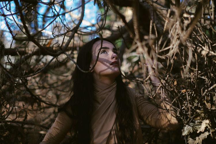 Woman among trees