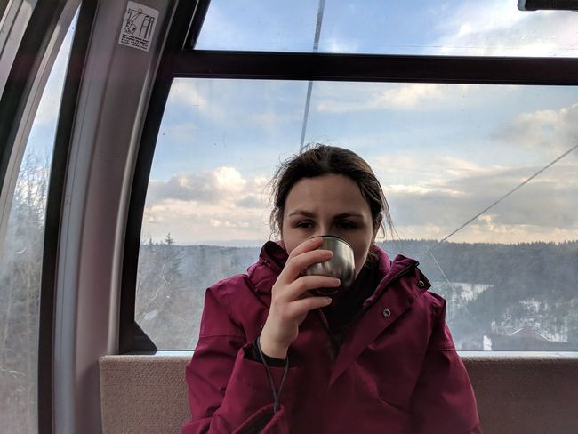 It's a tea break but then... one. more. run. // Real People One Person Sky Lifestyles Leisure Activity Window Transportation Cloud - Sky Front View Day Young Adult Young Women Warm Clothing Outdoors Nature Cable Lift Tired Google Pixel F/2.0 via Fotofall