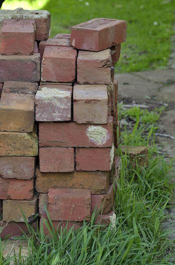 Pile of red bricks Brick Pile Bricks Grass Outdoors Pile Piled Up Red Bricks Stacked