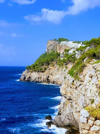 Port de Sóller Beach Beauty In Nature Blue Cliff Day Horizon Horizon Over Water Land Nature No People Outdoors Rock Rock - Object Rock Formation Scenics - Nature Sea Sky Solid Tranquil Scene Tranquility Water