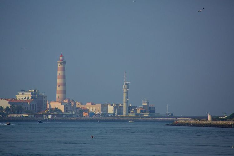 Aveiro Lighthouse In Front Of Sea Against Clear Sky