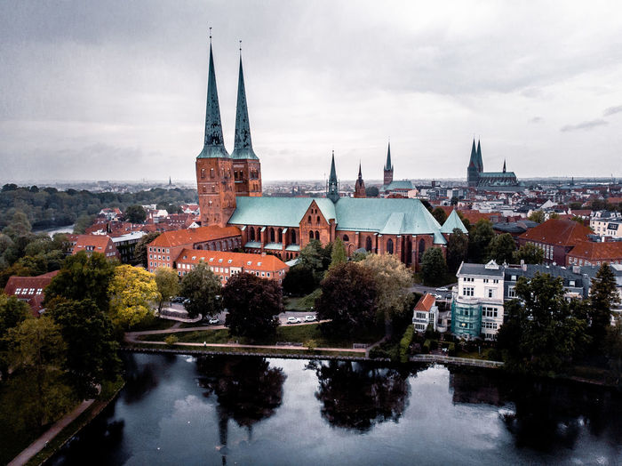 Panoramic view of buildings against sky in city from aerial view in lübeck, germany