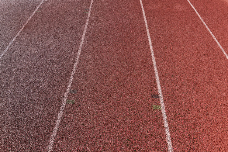 tartan running track Tartan Track Athletics Sport Running Stadium Competition Speed Lanes Sports Track High Angle View Full Frame Close-up No People Competitive Sport Running Track Track And Field Outdoors Track And Field Event Dividing Line