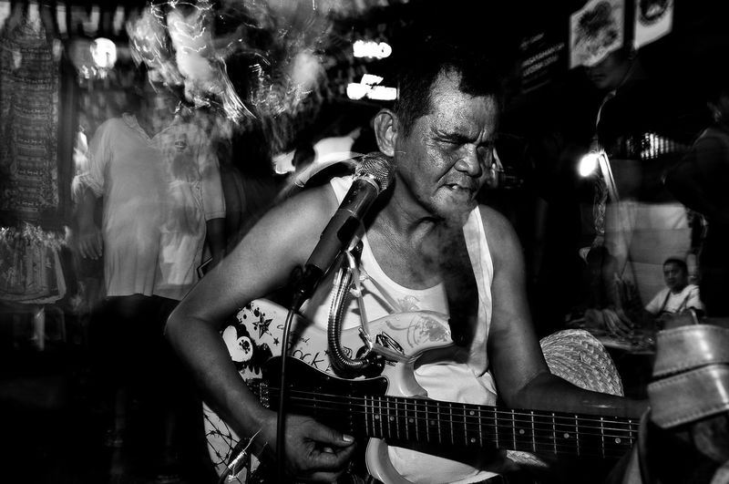 Flanuering in Black and White Black Black & White Black And White Black&white Blackandwhite Blackandwhite Photography Eyeem Philippines Flash Guitar Guitarist Night Philippines Smoking Street Street Photography Streetphoto Streetphoto_bw Streetphotography Streetphotography_bw The Street Photographer - 2016 EyeEm Awards Urban Urbanphotography