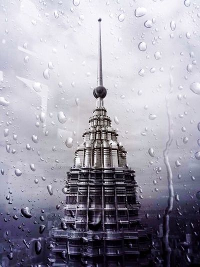 People And Places Kuala Lumpur Petronas Twin Towers Built Structure Sky Focus On Foreground No People Spire  Architecture Tall - High
