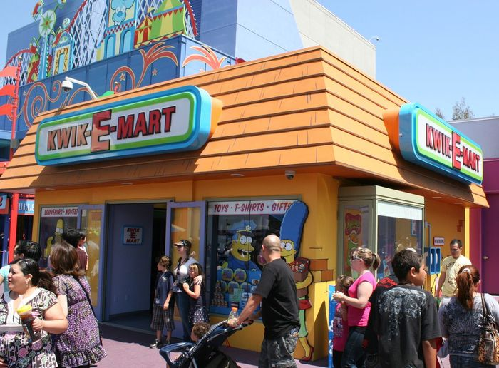 The Simpsons - Kwik-E-Mart Architecture Building Exterior Built Structure Cafe City Communication Crowd Day Entertainment Food Kwik-E-Mart Kwikemart Large Group Of People Men Outdoors People Real People Springfield Supermarket Text The Simpsons Universal Studios  Women