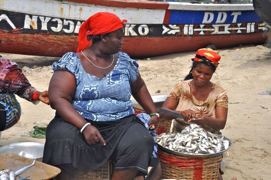 Cleaning Fish Africa African Bargain Beach Fish Fish Market Fish Scales Fishing Boat Friendship Ghana Head Scarf Livelihood Market Market Woman Poverty Scaling Fishes Women At Work Women Of Africa Women In Business Smiling Tradition Traditional Showcase May Woman Women