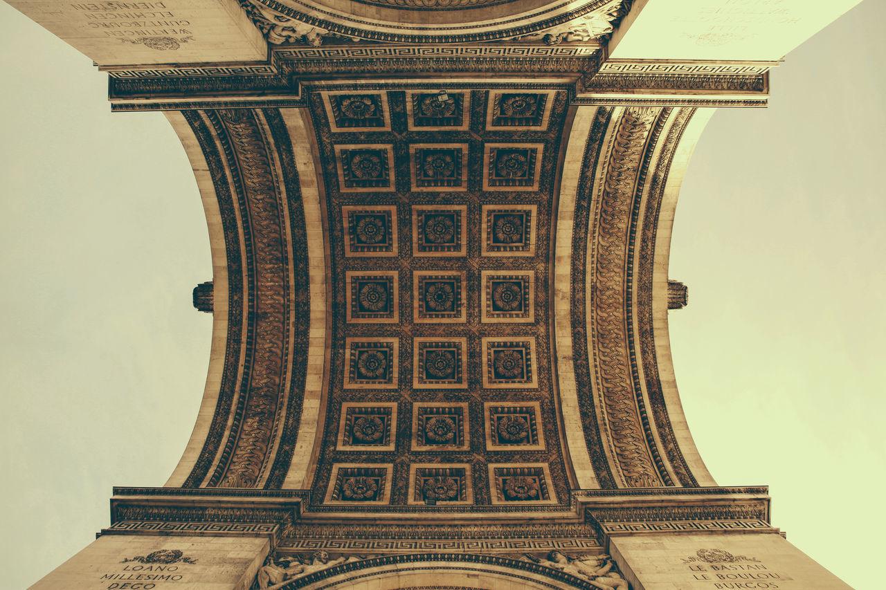 Directly below shot of arc de triomphe against sky