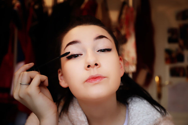 Teenager Teenage Girls Makeup Make-up Beauty Beautiful Woman Portrait Headshot Young Adult Young Women Applying Fashion Women Adult One Person Indoors  Focus On Foreground Lipstick Make-up Brush Holding Human Body Part Preparation  Glamour Body Part Backstage Hairstyle Human Face