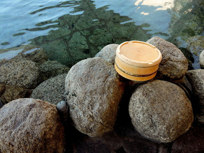 Backgrounds Bathe Close-up Hot Spring Hot Water Inviting Japanese Onsen No People Relaxation Rocks Stone Wooden Pail