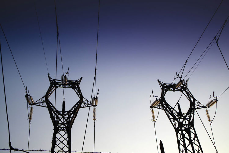 Sky Cable Electricity  Fuel And Power Generation Low Angle View Power Line  Electricity Pylon Connection Clear Sky Power Supply Technology No People Nature Complexity Silhouette Metal Outdoors Tall - High Blue Sunset Electrical Equipment Electrical Component