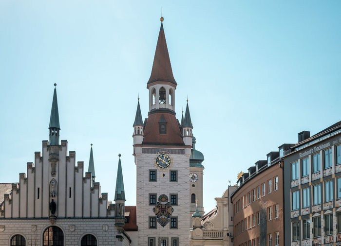 Architecture Blue Building Exterior Built Structure Cathedral Church City Day Façade High Section Low Angle View Marienplatz No People Outdoors Place Of Worship Religion Sky Spirituality Tourism Travel Destinations