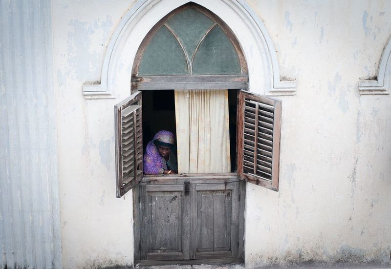 Stonetown Swaheli Style Zanzibar Tanzania Tranquility The Week On EyeEm Window Architecture One Person EyeEm Gallery Africa Day To Day Tourist Destination Street Walk Reportage Portrait Documentary Swahili Coast Swahili Costal Town