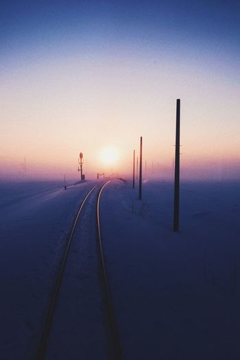 Silhouette of road during winter